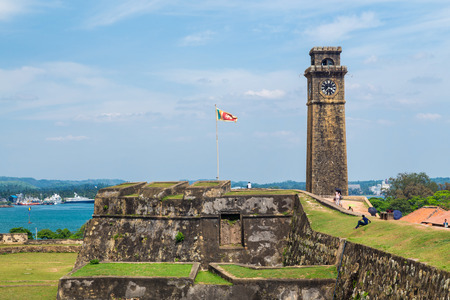 galle: GALLE, SRI LANKA - MARCH 9, 2014: Clock tower in Galle fort.  Fort was originally built in 1684 to house the Dutch Governor and his staff and today is UNESCO World Heritage Site Editorial