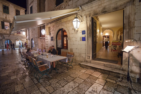ragusa: DUBROVNIK, CROATIA - MAY 27, 2014: People sitting at the table at restaurant Protos  terrace. Dubrovnik has many restaurants which offer traditional Dalmatian cuisine and some great wine lists. Editorial