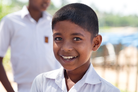 hatchery: HABARADUWA, SRI LANKA - MARCH 11, 2014: Portrait of school kid at Sea Turtle Farm and Hatchery. The center was started in 1986 and up to now they released more than 500,000 Turtles to ocean
