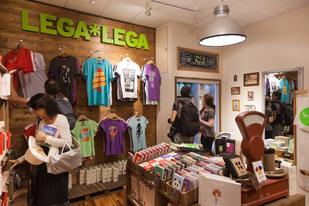 invented: DUBROVNIK, CROATIA - MAY 28, 2014: Tourists in Lega Lega, popular Croatian design store. All of their products are entirely invented, designed and produced in Croatia.