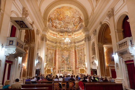 church people: DUBROVNIK, CROATIA - MAY 28, 2014: People on mass in Jesuit church of St. Ignatius. The church and collegium complex is considered to be the finest baroque set of buildings in Dubrovnik.
