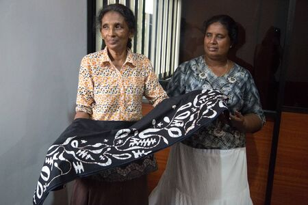 counterpane: COLOMBO, SRI LANKA - MARCH 12, 2014: Local women in batik workshop. The manufacture and export of textile products is one of the biggest industries in Sri Lanka.