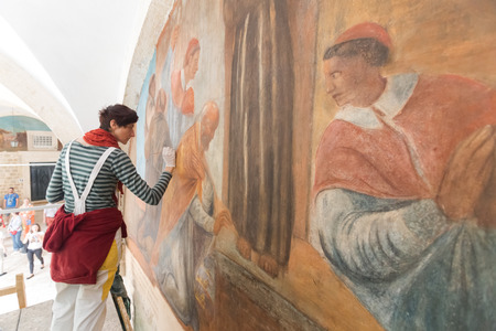 DUBROVNIK, CROATIA - MAY 26, 2014: Art conservation and restoration in the Franciscan Monastery in Dubrovnik. Sajtókép