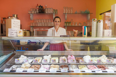 DUBROVNIK, CROATIA - MAY 26, 2014: Young waitress in Dolce vita, popular ice cream and cake shop.