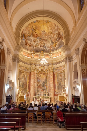 collegium: DUBROVNIK, CROATIA - MAY 28, 2014: People on mass in Jesuit church of St. Ignatius. The church and collegium complex is considered to be the finest baroque set of buildings in Dubrovnik.