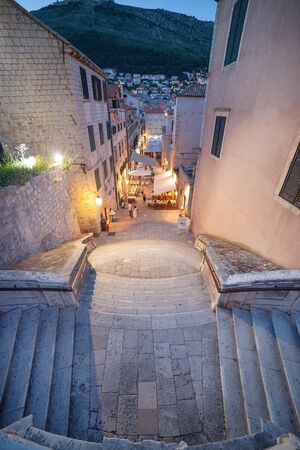 collegium: DUBROVNIK, CROATIA - MAY 26, 2014: Night shot of Jesuits staircase, the grand staircase that leads from Gundulic Square to the square in front of Collegium Ragusinum and St. Ignatius Church. Editorial