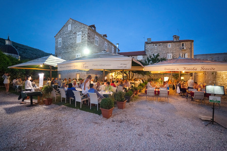 ragusa: DUBROVNIK, CROATIA - MAY 27, 2014: People sitting on terrace of Restaurant Kopun and Konoba Jezuite. Dubrovnik has many restaurants which offer traditional Dalmatian cuisine and some great wine lists.