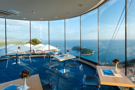window view: DUBROVNIK, CROATIA - MAY 26, 2014: Interior of restaurant near Dubrovnik cable car station. Cable car connects Ploce and mountain Srdj above town where you can enjoy a panoramic view of Old Town