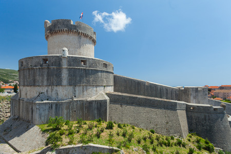 old flag: Minceta tower on old walls of Dubrovnik, Croatia. Tower is highest point of the wall and a symbol of unconquerable city of Dubrovnik