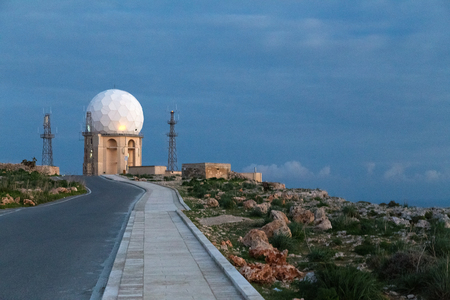 golfball: The Dingli Aviation Radar Site, Malta. It is operated by Malta Air Traffic Services.The site consists of the large golf-ball radar plus 4 short towers that have several VHF aerials attached.