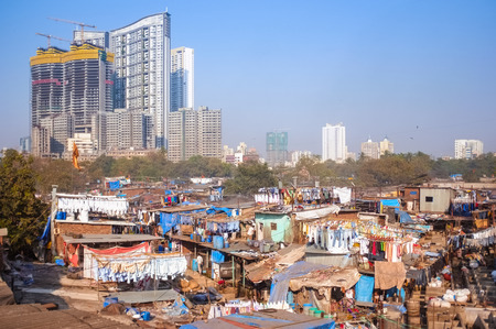 dhobi ghat: MUMBAI, INDIA - 08 JANUARY 2015: View of skyscrapper being built close to Dhobi ghat.