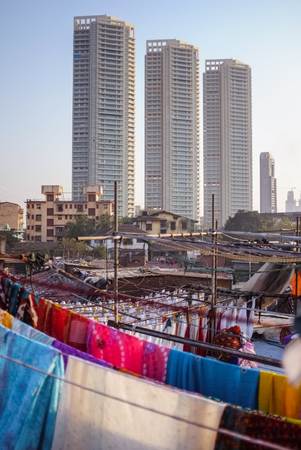 dhobi ghat: MUMBAI, INDIA - 08 JANUARY 2015: Urban scene with skycrappers and residential buildings taken from a roof top in Dhobi ghat.