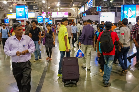 terminus: MUMBAI, INDIA - 10 JANUARY 2015: Crowd on Chhatrapati Shivaji Terminus Editorial
