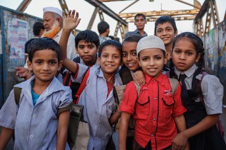 slum: MUMBAI, INDIA - 12 JANUARY 2015: Indian children after school in Dharavi slum