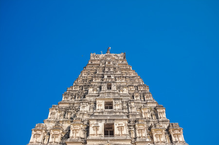 karnataka culture: HAMPI, INDIA - 28 JANUARY 2015: Virupaksha Temple is located in Hampi in southern India. It is part of the Group of Monuments at Hampi, designated a UNESCO World Heritage Site Editorial