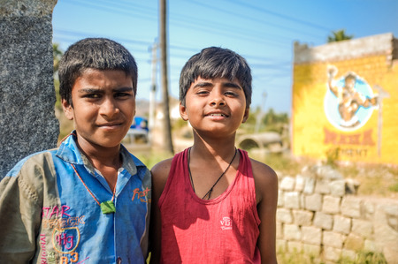 HAMPI, INDIA - 01 FEBRUARY 2015: Two Indian boys in street on a sunny day