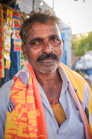 bathing man: KAMALAPURAM, INDIA - 02 FABRUARY 2015: Indian man before bathing in a town close to Hampi Editorial