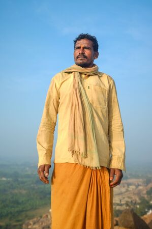 spiritualism: KAMALAPURAM, INDIA - 03 FEBRUARY: Indian pilgrim with scarf in a lungi and painted forehead on hilltop