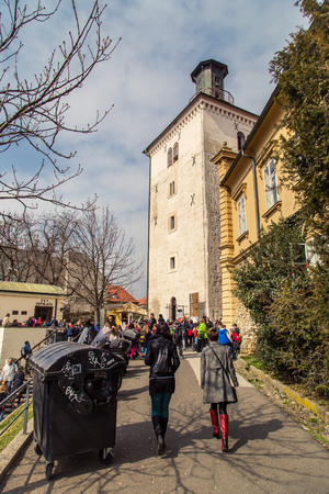 17 march: ZAGREB, CROATIA - 17 MARCH 2015: Lotrscak tower with its canon on a sunny day with tourists around it.