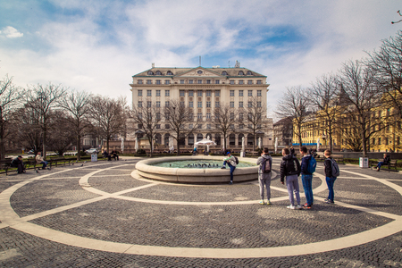 17 march: ZAGREB, CROATIA - 17 MARCH 2015: A side view of the main entrance to the Esplanade Hotel in Zagreb from a park with a fountain with school boys taking a picture. Editorial