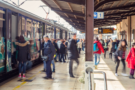 trafic: ZAGREB, CROATIA - 17 MARCH 2015: People entering and exiting a train on platform number 1 in Glavni kolodvor (main train station).