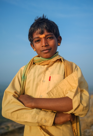 spiritualism: KAMALAPURAM, INDIA - 03 FEBRUARY: Young Indian pilgrim with scarf and bindi on hilltop