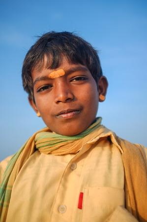 indian culture: KAMALAPURAM, INDIA - 03 FEBRUARY: Young Indian pilgrim with scarf and bindi on hilltop