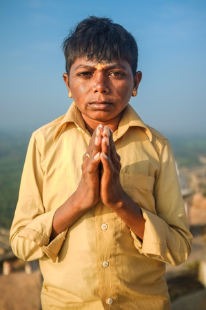 spiritualism: KAMALAPURAM, INDIA - 03 FEBRUARY: Indian pilgrim with hands in praying position on hilltop