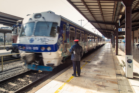 17 march: ZAGREB, CROATIA - 17 MARCH 2015: Controler next to a train that has just departed.