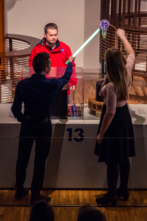 17 march: ZAGREB, CROATIA - 17 MARCH 2015: Museum staff showing an exibition to visitors in the Tesla part of the museum in Tehnicki muzej in Zagreb.