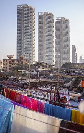 ghat: MUMBAI, INDIA - 08 JANUARY 2015: Urban scene with skycrappers and residential buildings taken from a roof top in Dhobi ghat.