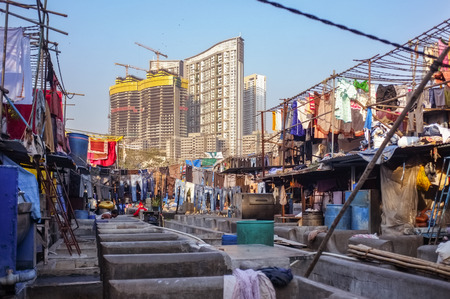 dhobi ghat: MUMBAI, INDIA - 08 JANUARY 2015: View of skyscrapper being built close to Dhobi ghat in Mumbai.