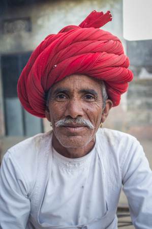 red indian: GODWAR REGION, INDIA - 12 FEBRUARY 2015: Rabari tribesman with traditional turban and clothes. Rabari or Rewari are an Indian community in the state of Gujarat. Editorial