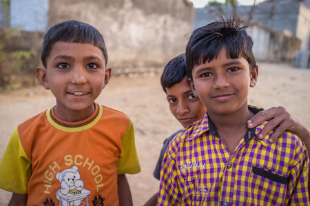 three generation: GODWAR REGION, INDIA - 12 FEBRUARY 2015: Three boys from Rabari tribe. Loss of tradition gains pace from every new generation. Rabari or Rewari are an Indian community in the state of Gujarat.