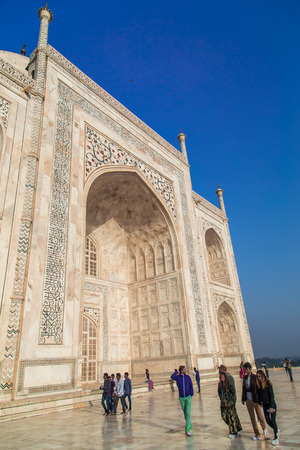indian culture: AGRA, INDIA - 28 FEBRUARY 2015: East side of Taj Mahal with visitors.