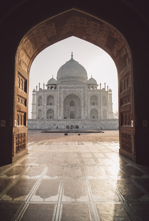 love dome: View of Taj Mahal from mosque with sun reflection. West side. Post-processed with grain, texture and colour effect. Stock Photo