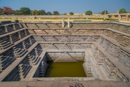 temple tank: HAMPI, INDIA - 30 JANUARY 2015: Stepped tank in Hampi, a UNESCO World Heritage Site. Editorial