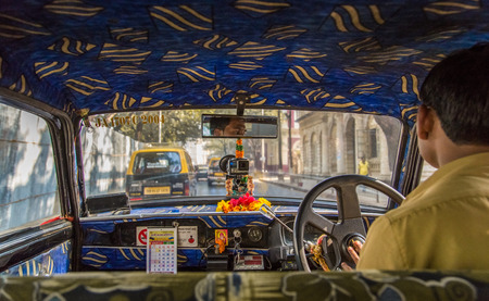MUMBAI, INDIA - 17 JANUARY 2015: Old taxi's upholstery in Mumbai are decorated Indian style. Editorial