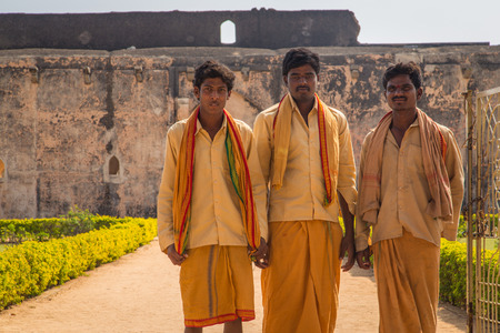 prevalent: HAMPI, INDIA - 30 JANUARY 2015: Three pilgrims in front of Queens bath, colossal bath that exemplifies the architectural excellence prevalent during the days of the Vijayanagara Empire.