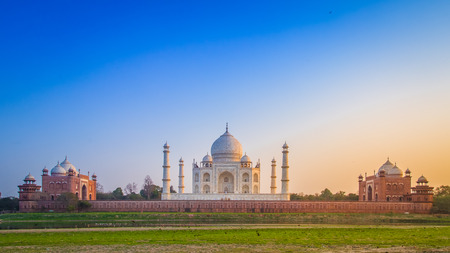 monument in india: Panorama of the Taj Mahal from north side across the Yamuna river at sunset.