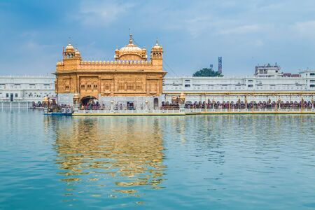 gurdwara: AMRITSAR, INDIA - 01 MARCH 2015: Pilgrims at the Golden Temple, the holiest Sikh gurdwara in the world.