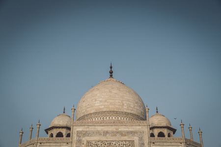 side effect: Close up view of Taj Mahal from East side. Roof part. Post-processed with grain, texture and colour effect. Stock Photo