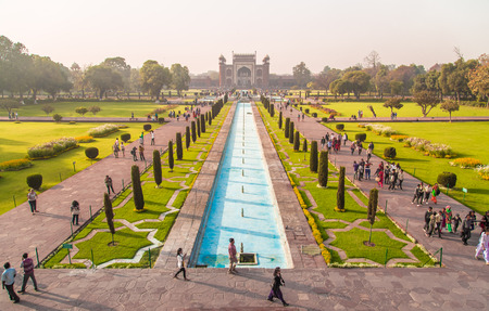 north gate: AGRA, INDIA - 28 FEBRUARY 2015: View of North side of Great Gate from Taj Mahal with visitors walking in gardens.