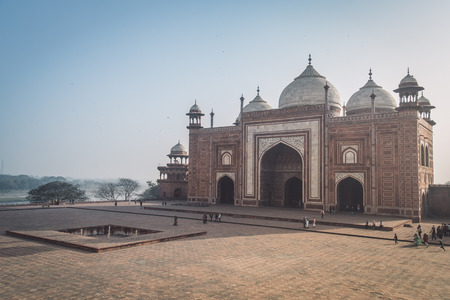 side effect: AGRA, INDIA - 28 FEBRUARY 2015: View of Mihman Khana from South-East side of Taj Mahal. Post-processed with grain, texture and colour effect.