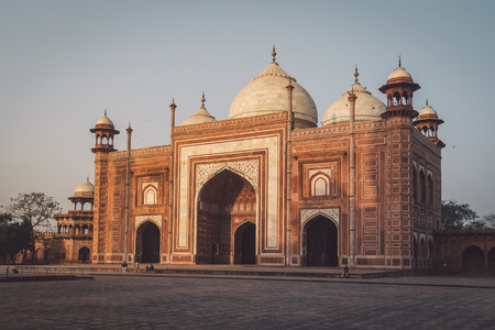 love dome: AGRA, INDIA - 28 FEBRUARY 2015: Mosque on the West side of Taj Mahal. Post-processed with grain, texture and colour effect.