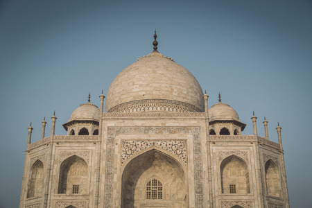 upper half: Close up view of Taj Mahal from East side. Upper half. Post-processed with grain, texture and colour effect. Stock Photo