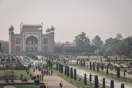 love dome: AGRA, INDIA - 28 FEBRUARY 2015: AGRA, INDIA - 28 FEBRUARY 2015: View of North side of Great Gate from Taj Mahal with visitors. Post-processed with grain, texture and colour effect. Editorial