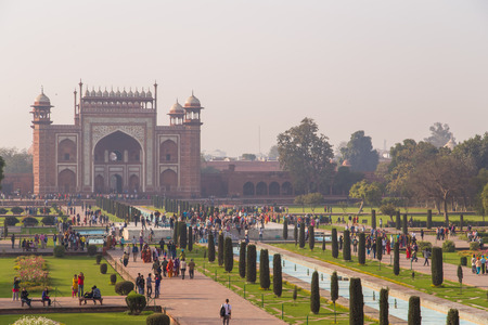 love dome: AGRA, INDIA - 28 FEBRUARY 2015: AGRA, INDIA - 28 FEBRUARY 2015: View of North side of Great Gate from Taj Mahal with visitors.