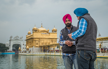 sikh: AMRITSAR, INDIA - 01 MARCH 2015: Pilgrims at Golden Temple, the holiest Sikh gurdwara in the world. Editorial