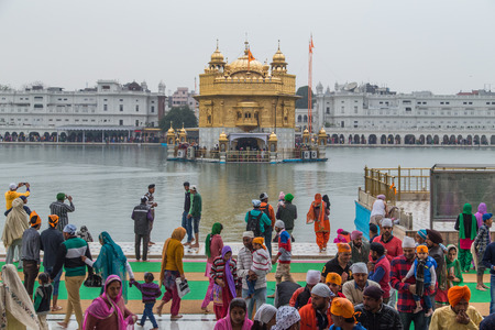 darbar: AMRITSAR, INDIA - 01 MARCH 2015: Pilgrims at the Golden Temple, the holiest Sikh gurdwara in the world.